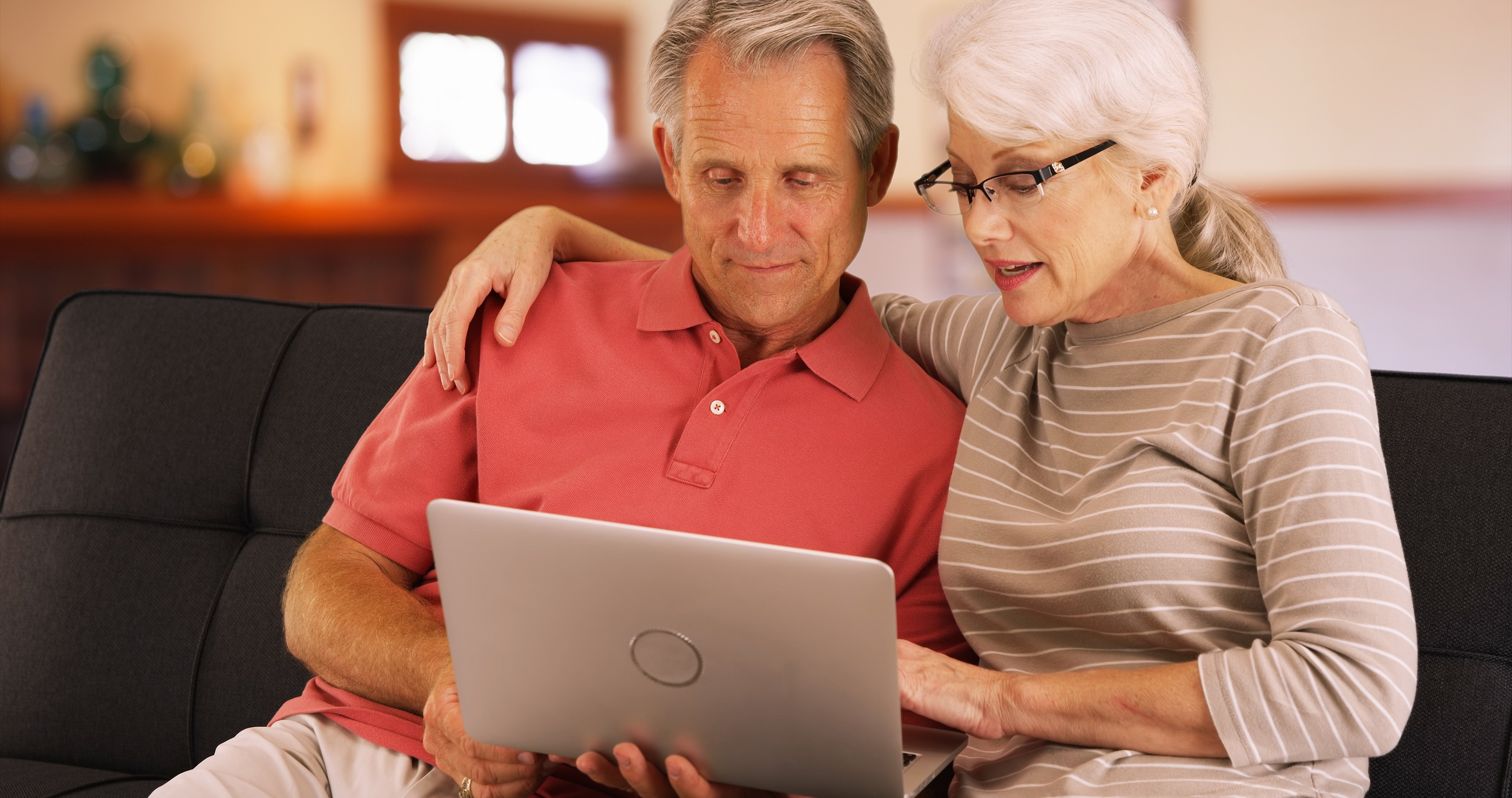Older couple looking at computer